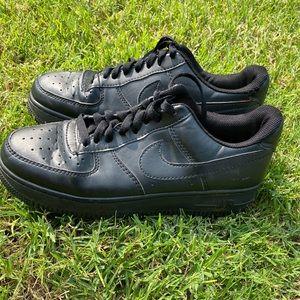 Black Nike Air Forces.